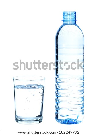 Bottle and glass with water on white background. - stock photo