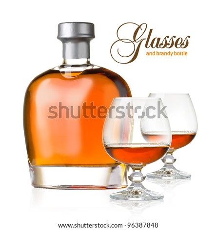 bottle and glasses brandy on white background - stock photo
