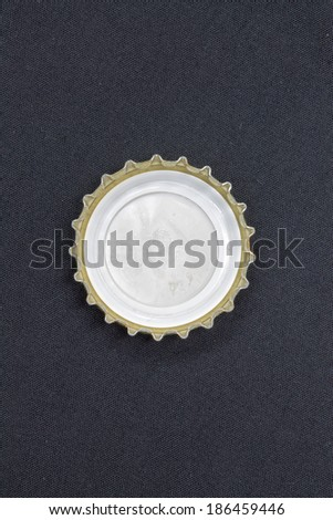 bottle cap on a black background - stock photo