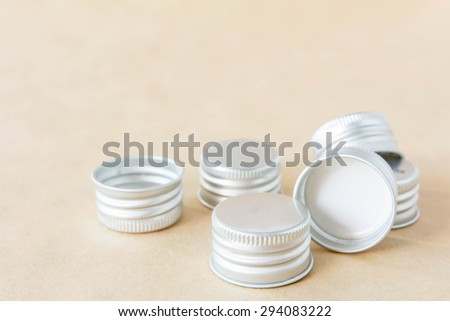 Bottle cap on a brown background. - stock photo