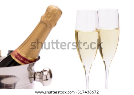 bottle champagne in ice cooler with two glasses