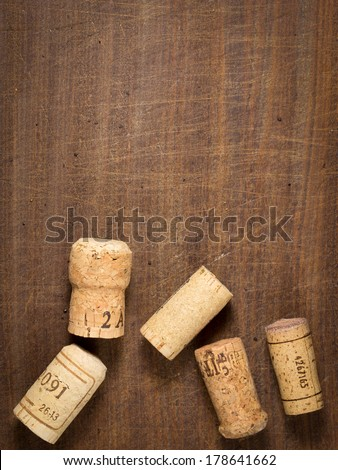 Bottle corks for champagne or wine on a wooden background with copyspace - stock photo