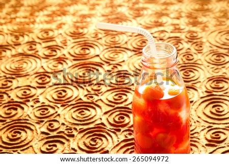 Bottle delicious refreshing drink of vibrant watermelon with drinking straw, infusioned water, soft focus and warm tone - stock photo
