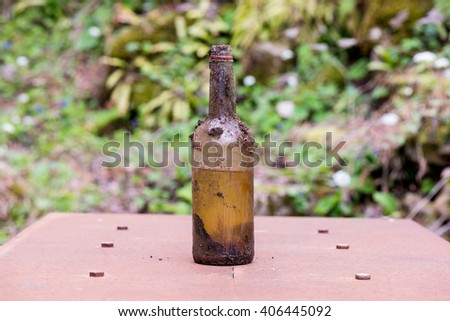 bottle dirt dust old glass detail macro - stock photo