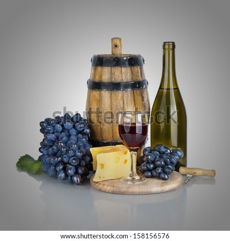 bottle, glass of wine,  ripe grapes and cheese  - stock photo