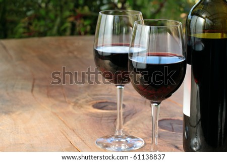 Bottle & Glasses of Red Wine on Table