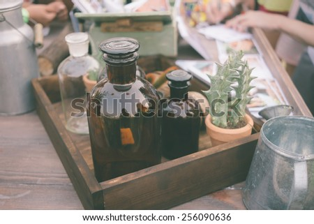 Bottle in wooden box at festival market vintage color