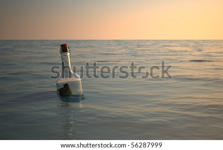 Bottle message floating around in calm ocean - stock photo