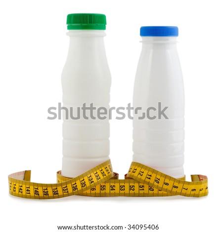 bottle milk and yogurt with tape measure - stock photo