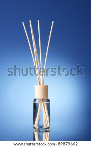 Bottle of air freshener on blue background
