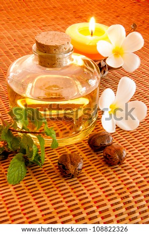 Bottle of aromatic essence oil and fresh  Frangipani.