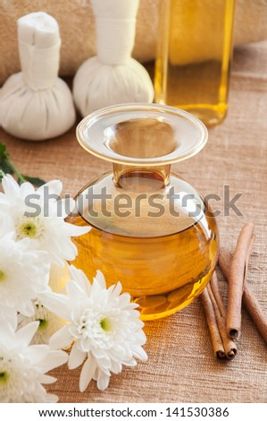 Bottle of aromatic essence oil in relaxing spa scene. - stock photo