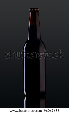 bottle of beer on a dark background - stock photo