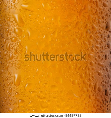 bottle of beer with water drops as background