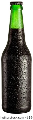 Bottle of black beer with drops on white background. The file contains a path to cut. - stock photo