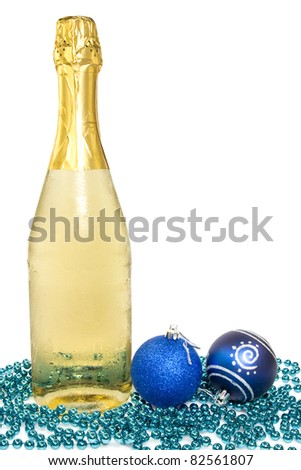 Bottle of champagne and christmas baubles over white background.