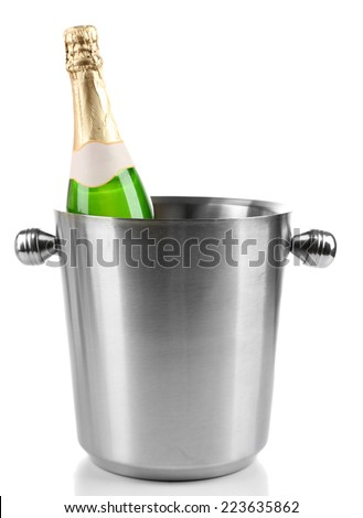 Bottle of champagne in bucket, isolated on white - stock photo