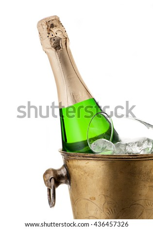 Bottle of champagne in bucket on a white background