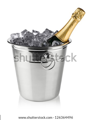 bottle of champagne in cooler with ice cubes - stock photo