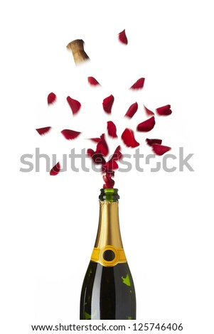 Bottle of champagne popping red rose petals with cork into the air on white background - stock photo