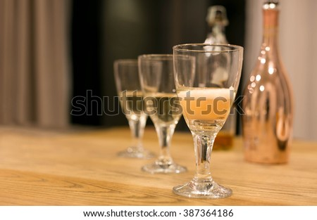Bottle of Champagne  with glasses on the table celebration - stock photo