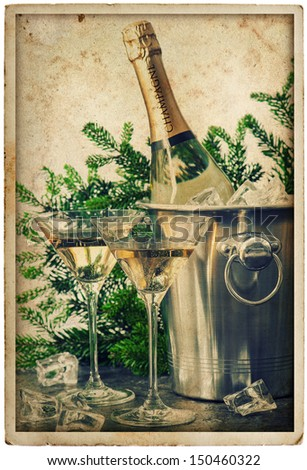 bottle of champagne with two glasses. festive decoration. grunge picture in retro postcard style - stock photo