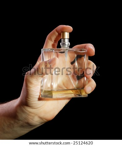 Bottle of cologne in a hand at the man