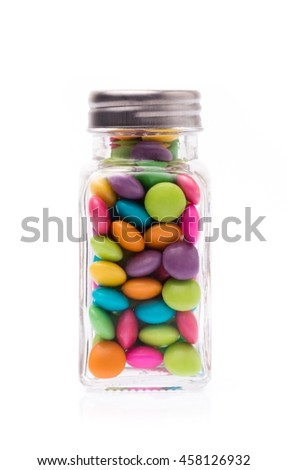 bottle of colorful chocolate coated candy isolated on white background