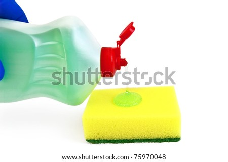 Bottle of detergent, a yellow sponge, green transparent gel, hand in glove blue isolated on white background - stock photo