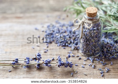 Bottle of dry lavender flowers. Selective focus. - stock photo