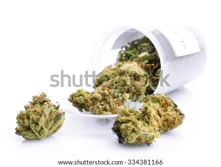 Bottle of dry medical cannabis isolated on white - stock photo