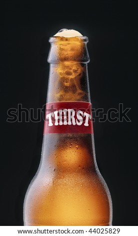 """Bottle of fresh beer with """"thirst"""" brand - stock photo"""