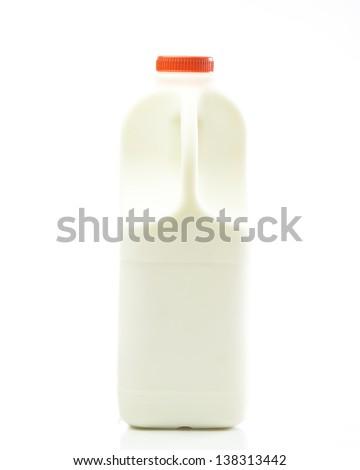 bottle of fresh milk isolated against white background. - stock photo