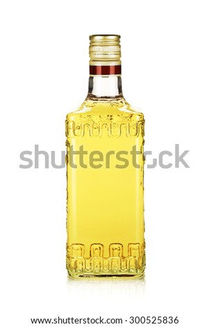 Bottle of gold tequila. Isolated on white background - stock photo
