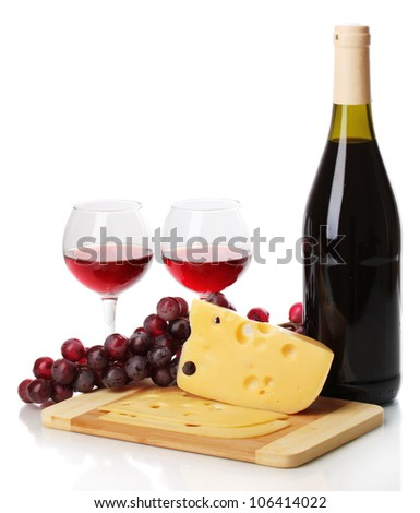 Bottle of great wine with wineglasses and cheese isolated on white