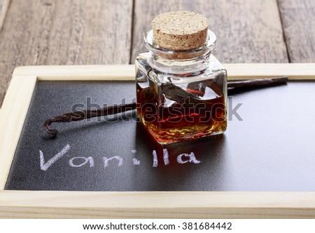 Bottle of homemade vanilla essence - stock photo