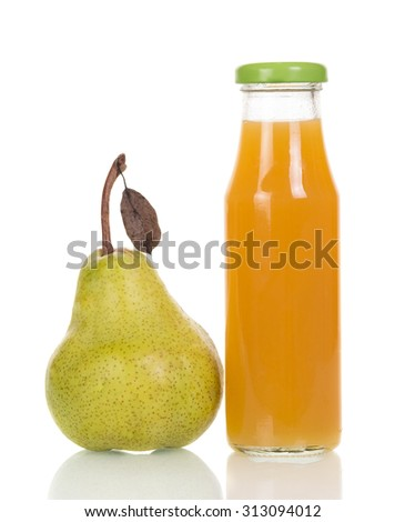 Bottle of juice and ripe pear - stock photo