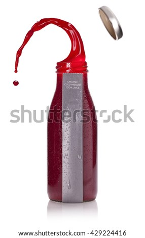 Bottle of juicy red liquid with blank label and popped cap isolated over white background - stock photo