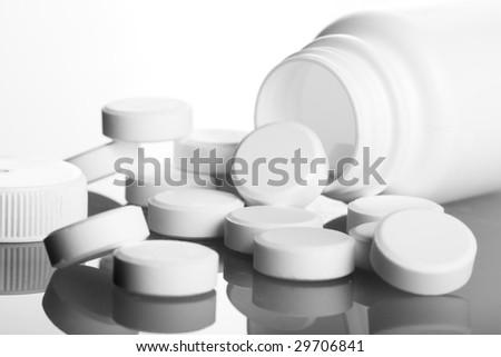 bottle of medication white pills - stock photo