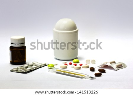 BOTTLE OF MEDICINE,  PILLS  AND TERMOMETR - stock photo