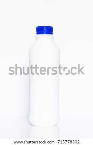 Bottle of milk on white background with reflection