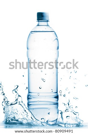 bottle of mineral water is standing in splashing water, cut out from white - stock photo