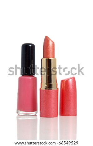 Bottle of nail polish and red lipstick on white background - stock photo