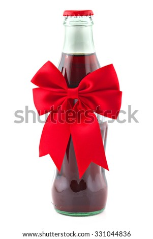 Bottle of non-alcohol drink with christmas ribbon isolated on white, shallow focus - stock photo