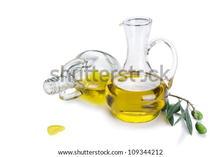 Bottle of olive oil and fresh olive branch with olives isolated on white background