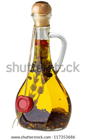 bottle of olive oil with herbs and spices isolated over white background - stock photo