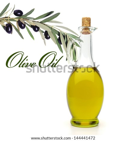 Bottle of olive oil with olives on branch on white background