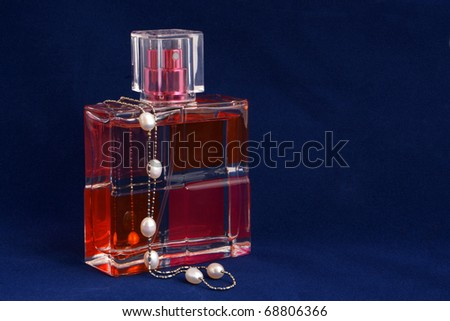 Bottle of perfume on a blue background