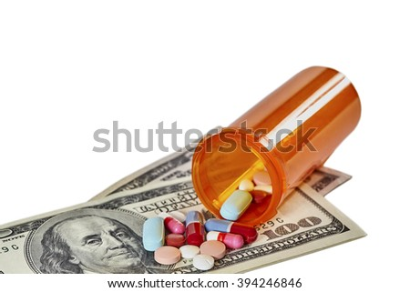 Bottle of prescription medications laying on top of a one hundred dollar bill and a prescription form isolated on white - stock photo