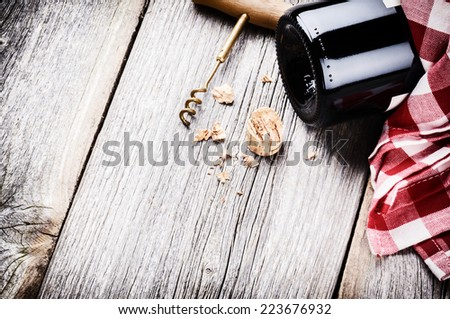Bottle of red wine in rustic setting. Wine list concept - stock photo